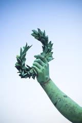 Laurel Wreath hand held by a bronze statue