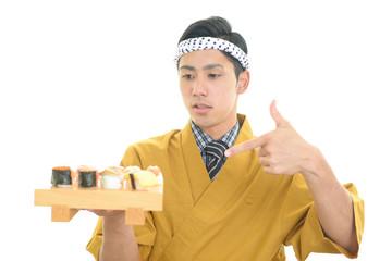 微笑む寿司職人