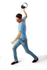 Angry male throwing headphones