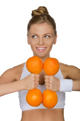 girl and dumbbell of oranges, looks to the side
