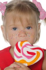 Little beautiful girl with colored Lollipop