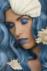 woman with blue hair and seashells