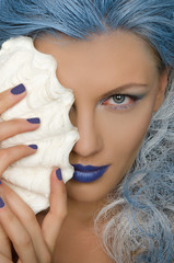 woman with blue hair and shell of person