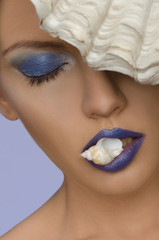 woman with shell in his mouth and face