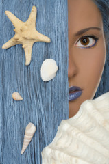 woman with blue hair, shells, looking at camera