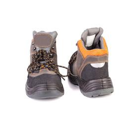 Pair of black and orange men boots.