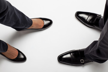 Businessman's and businesswoman's legs