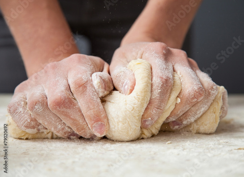 Fotobehang Koken Woman's hands knead dough