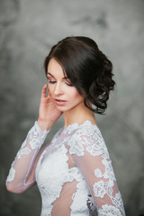 Close up of beautiful bride with perfect makeup and hair style