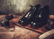 Shoe care accessories on a wooden table - 79022092