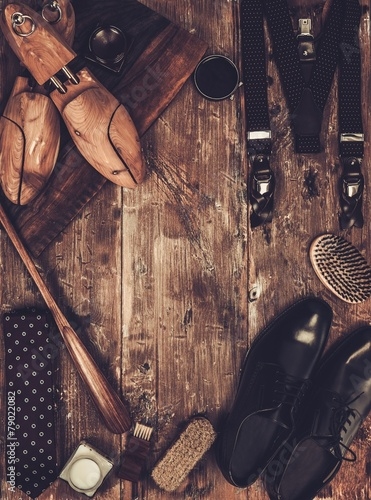 Shoe care and gentleman's accessories on a wooden table - 79022082