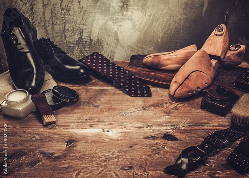 Shoe care and gentleman's accessories on a wooden table - 79022088