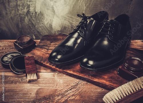 Leinwandbild Motiv Shoe care accessories on a wooden table