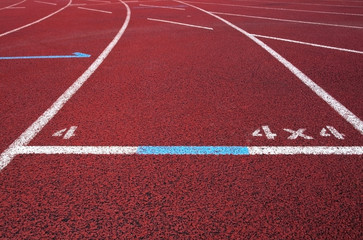 Red running field track with arrows and lines.