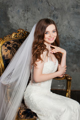 Photo of a beautiful smiling happy bride in luxurious wedding