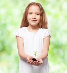 Child holding a sleedling