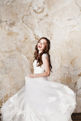Beautiful happy smiling bride with perfect makeup and hair style
