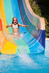 Child rolling with waterslides