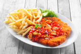 Crumbled Escalope with Sauce Paired with Fries