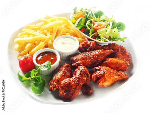 Leinwandbild Motiv Gourmet Fried Chicken with Fries and Veggies