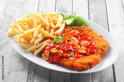 Foto op Canvas Grill / Barbecue Crumbled Escalope with Sauce Paired with Fries