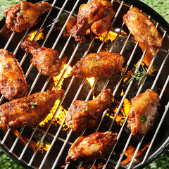 Crispy brown grilled chicken pieces on a BBQ