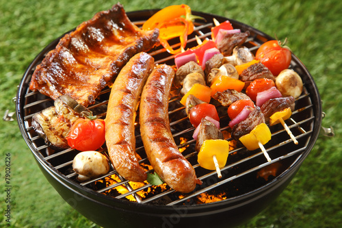 Assorted grilled meat on a summer barbecue - 79026226