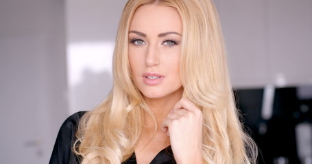 Close up Seductive Woman Touching her Blond Hair
