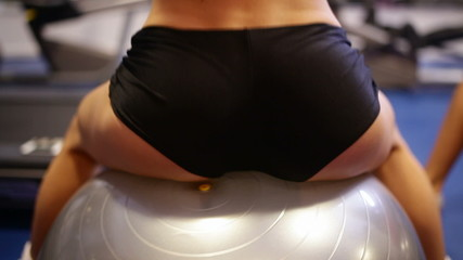 buttocks on the gym ball