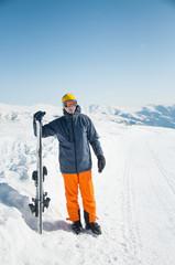 Skier sportsman at winter ski resort panoramic background