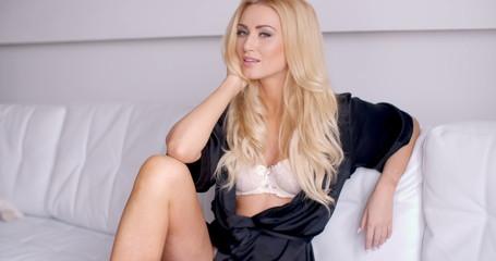 Pretty Female in Sleepwear Sitting on White Sofa