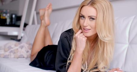 Blond Woman in Black Nightwear Lying on Couch