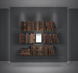 Tablet/ebook among books on shelf. Evolution of technology.