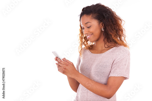 African American young woman sending a text message on her smart - 79028675