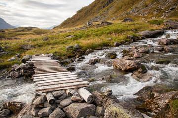 Norwegian mountain autumn landscape with bridge near Geiranger