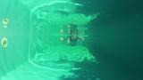Pretty girl in bikini swimming in the pool underwater