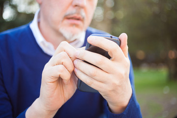 Mature man using a mobile phone