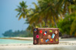 Travel vintage suitcase is alone on a beach - 79030454