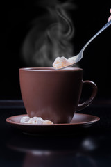 brown cup with steam isolated