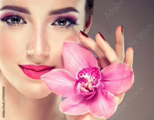 Spring model with  flower in   hand , fashion makeup .Cosmetics