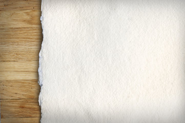 Old white paper on wooden background