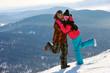Happy snowboarding couple