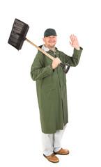 Worker holding black shovel.