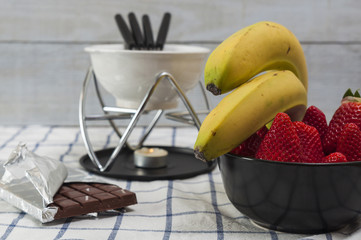 Strawberries and bananas for a chocolate fondue