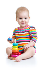 child baby playing with color pyramid toy
