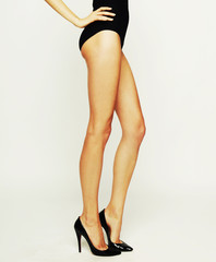 woman's legs in high-heeled black shoes