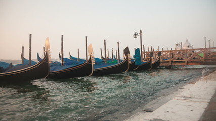 Venetian gondolas tied near the pier