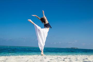 young girl dance at tropical beach, maldives