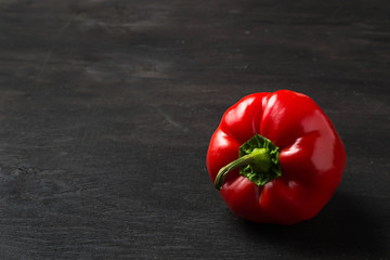 Sweet Bulgarian pepper on dark background