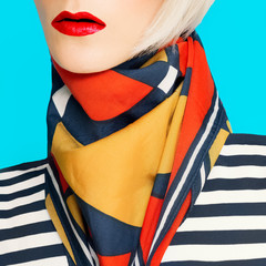 Lady in fashionable summer accessory. Scarf with geometric patte